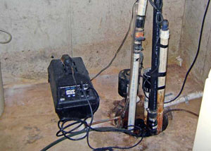 Pedestal sump pump system installed in a home in Toney
