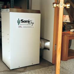 A basement dehumidifier with an ENERGY STAR® rating ducting dry air into a finished area of the basement  in Fayetteville