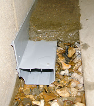 A basement drain system installed in a Harvest home