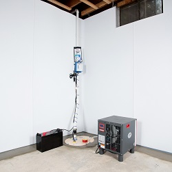 Sump pump system, dehumidifier, and basement wall panels installed during a sump pump installation in Muscle Shoals