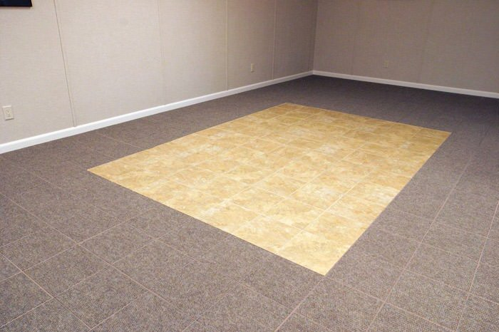 tiled and carpeted basement flooring installed in a Florence home