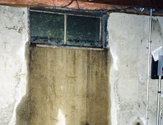 Water pouring out from a basement window in Athens
